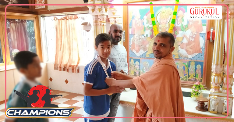 swami blessing to karate champion